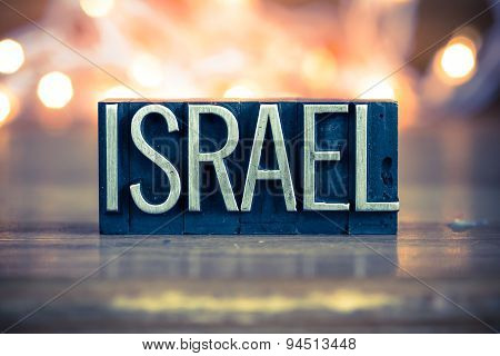 The word ISRAEL written in vintage metal letterpress type on a soft backlit background. poster