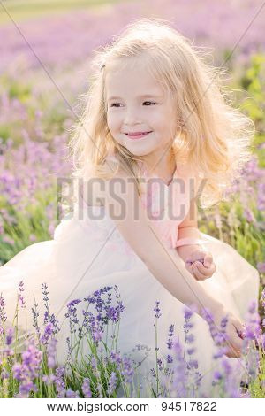 Happy Toddler Girl In Lavender