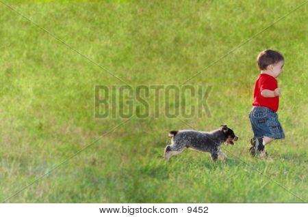 Boy Running From Puppy
