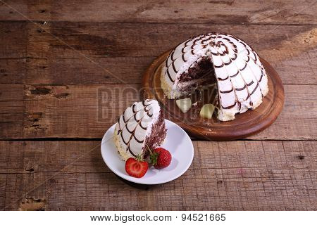 Pie Of Pancho From A Chocolate Biscuit And The Pineapple Slices, Decorated With The Swept Away Cream