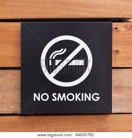 No Smoking Sign On A Wood Wall