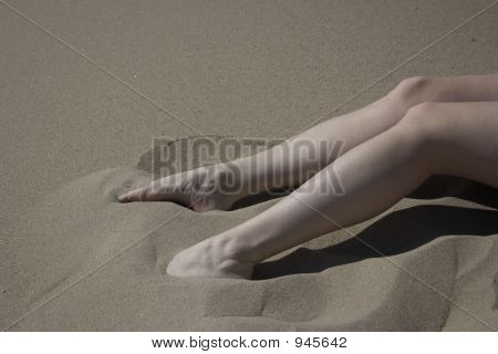 Woman'S Feet/Legs In Teh Sand