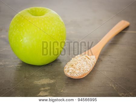 Green Apple On The Table
