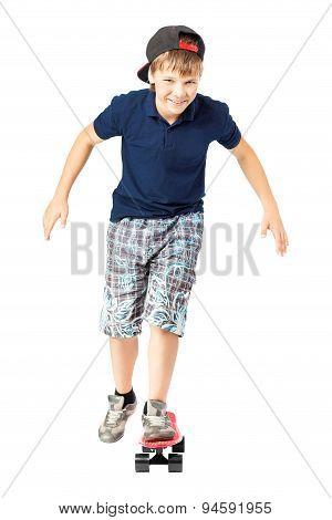 Adorable teenager riding a skateboard