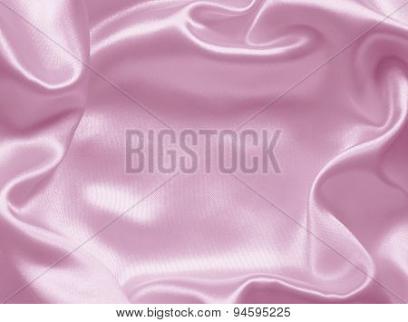 Smooth elegant pink silk or satin texture can use as background poster