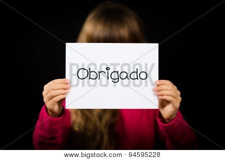 Child Holding Sign With Portuguese Word Obrigado - Thank You