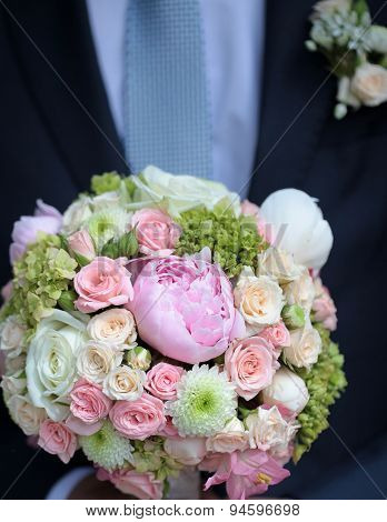 Bridegroom With Buch Of Flowers