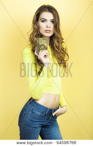 Alluring Woman With Golden Camera