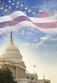 The US Capitol building with a waving American flag superimposed on the sky poster