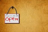 come in we are open hanging sign isolated on wall for adv or others purpose use poster