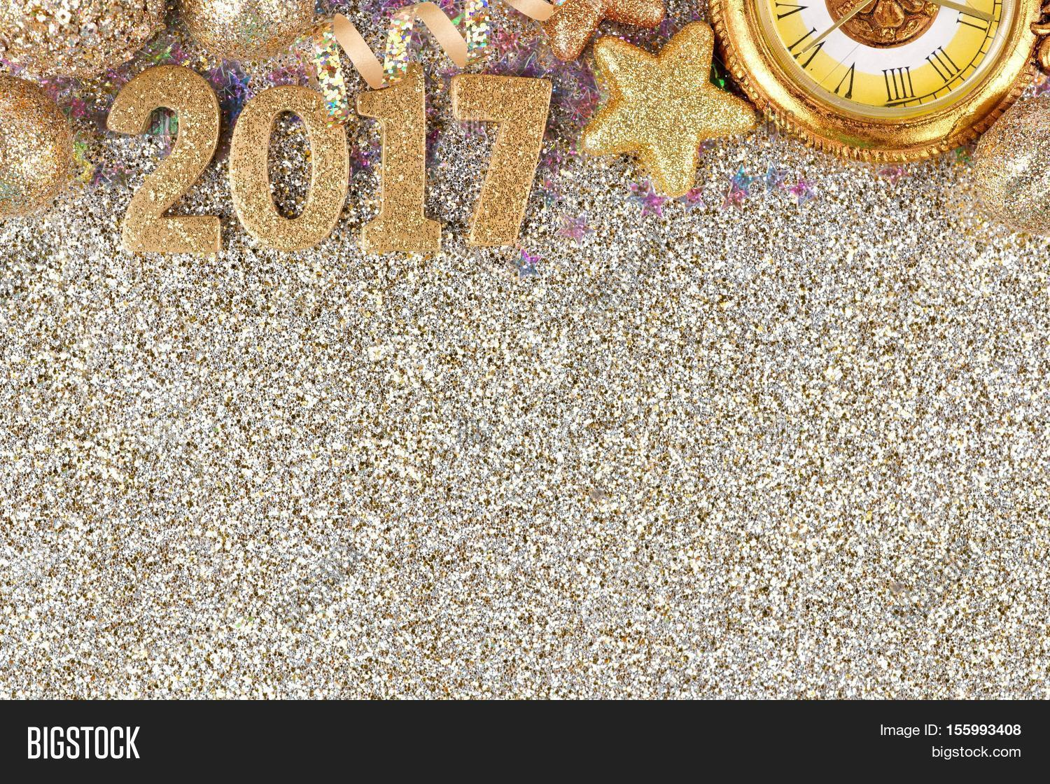 New Years Eve 2017 Golden Numbers With Top Border Of Decorations Over A Glittery Background