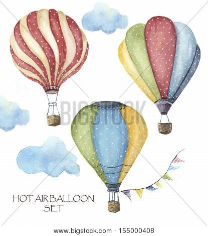 Watercolor hot air balloon polka dot set. Hand drawn vintage air balloons with flags garlands, clouds and retro design. Illustrations isolated on white background.