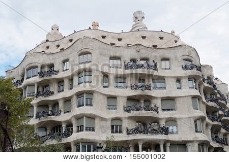 Barcelona, Spain - 24 September 2016: Casa Mila La Pedrera facade by Gaudi. Casa Mila La Pedrera in Catalonia, Spain was designed and constructed by architect Antoni Gaudi between 1906 and 1912.