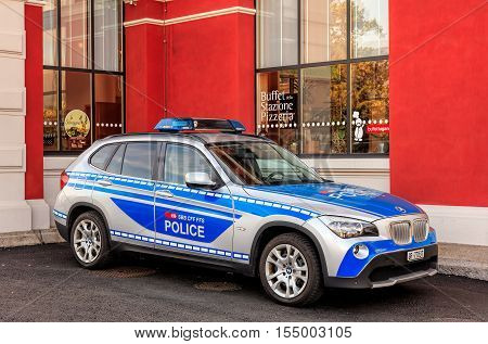Lugano, Switzerland - 12 October, 2016: a transport police car from the Swiss canton of Graubunden parked at the railway station building in the city of Lugano in the Swiss canton of Ticino.