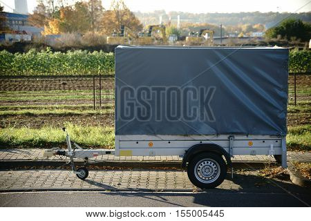 A car trailer for transporting small objects tools and materials.