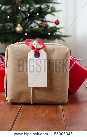 Parcel And Gifts On Wood With Christmas Tree