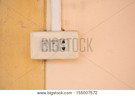 Electrical switch and plug on wall .