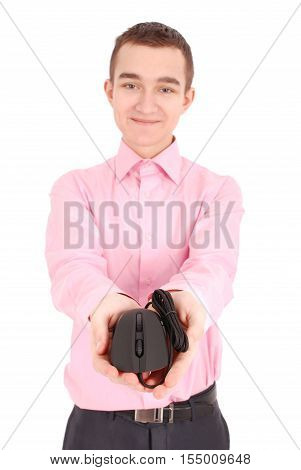 Young man holds in his hand black computer optical mouse isolated on white background