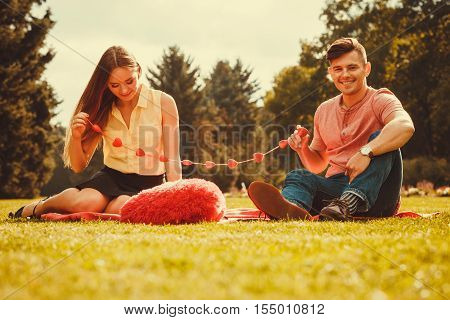 Love romance relationship dating concept. Enamoured couple in park. Girl and boy in park on picnic. poster