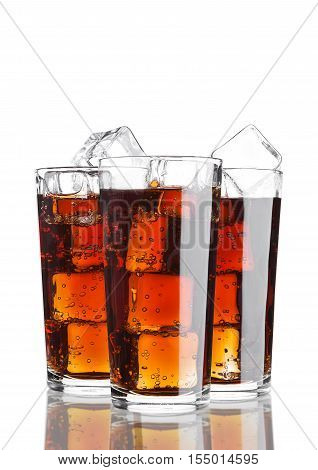 Glasses of cola soda drink cold with ice cubes on white background with reflection