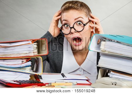 Emotions shock corporation clerk administration concept. Panicked secretary at desk. Young nervous lady doing job in office.