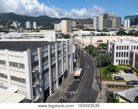 HONOLULU HI - JULY 12 2016: Aerial view of street with Bus Iwilei buildings cityscape on island of Oahu in the state of Hawaii. July 12 2016 Honolulu Hawaii.