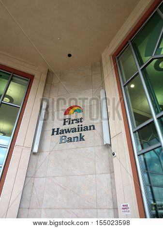 HONOLULU - APRIL 3: First Hawaiian Bank logo on side of Building in Honolulu Hawaii. Taken on April 3 2014. First Hawaiian Bank is a regional commercial bank headquartered in Honolulu Hawaii at the First Hawaiian Center.