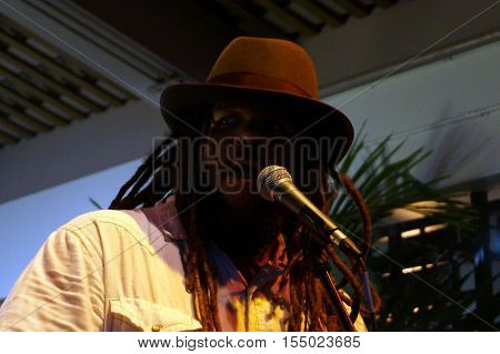 HONOLULU HI - APRIL 23: Close-up Lead singer of Guidance Band Keith Batlin singing on stage at Mai Tai Bar in Ala Moana Shopping Center on April 23 2016 Honolulu Hawaii.