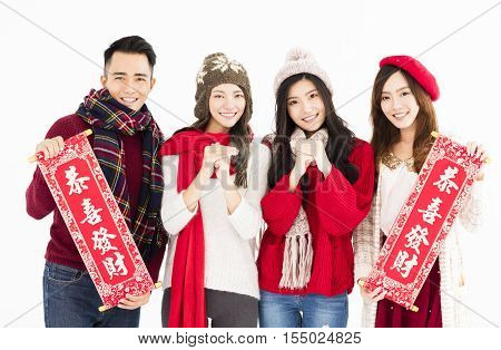 young asian group showing Spring festival couplets.chinese mean: happy chinese new year and good luck