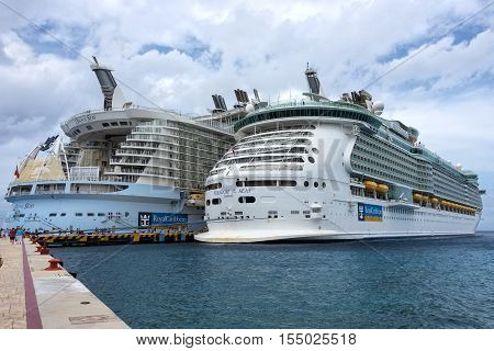 Cozumel Mexico - November 2nd 2016: Two of the largest Royal Caribbean ships The Freedom of the Seas and The Oasis of the Seas dock together in Cozumel Mexico before exchanging their home port Cape Canaveral Florida on November 5th 2016.