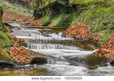 Whitewater in Indiana's Fall Creek Gorge tumbles down rocky ledges and swirls in carved