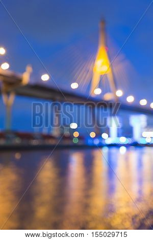 Blurred lights suspension bridge over watergate at twilight