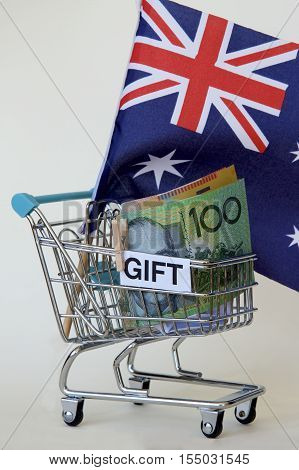 Australian flag and dollars in a trolley.