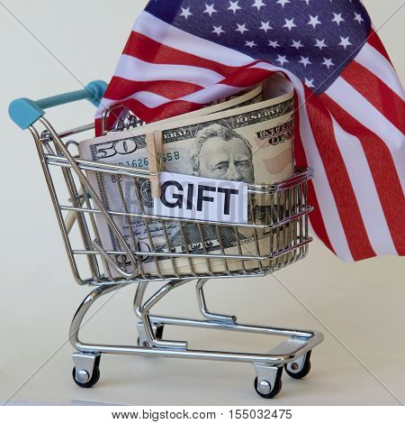 American flag and money in a trolley as a gift.