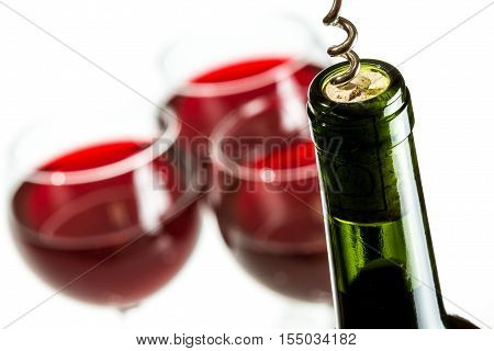 Closeup of opening wine bottle on white background