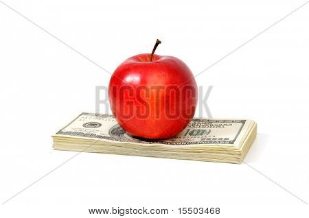 apple and dollars isolated on a white background