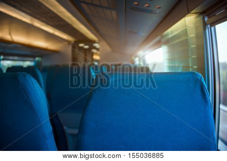 Empty seats interior by window in train.