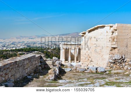 Ancient temple of Athena Nike in Acropolis, Athens, Greece and city panorama