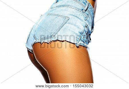 Sexy perfect female woman buttocks sunbathed ass in jeans shorts isolated on white