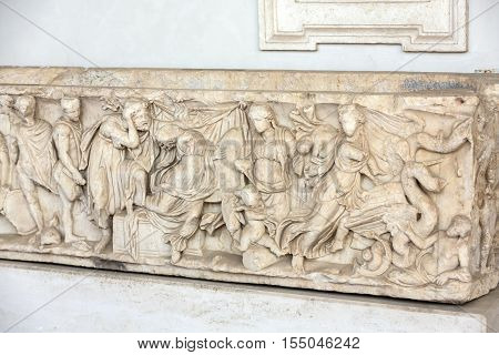 ROMA, ILTALY - JUNE 12, 2015: Bas-relief on the ancient sarcophagus in the baths of Diocletian in Rome. Italy