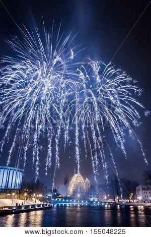 Spectacular blue fireworks at night on black background