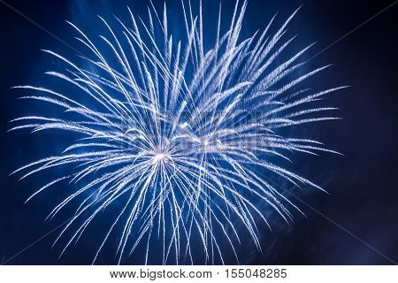 Blue fireworks during the celebrations event on black background