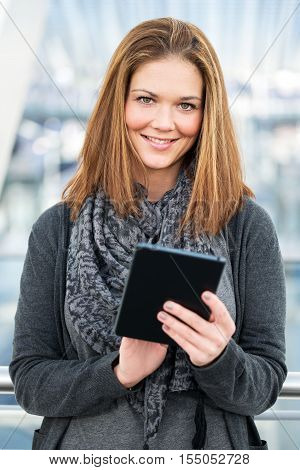 Friendly Young Woman Using Tablet