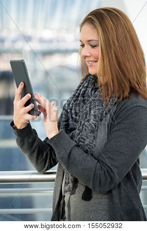 Young Woman Operating Tablet With Finger