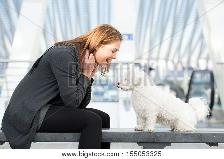 Young Woman Exercises With Maltese Dog