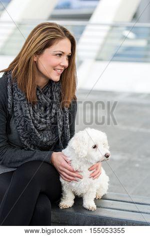 Young Woman Cuddling Maltese Dog