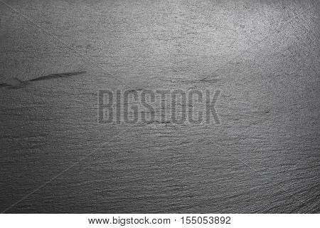 tile with shale texture forming black background