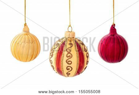 Set of red and gold balls and gold stars isolated on white background.