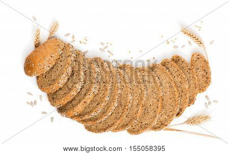 Top view of slices of multigrain organic bread decorated with natural cereals isolated on white background.