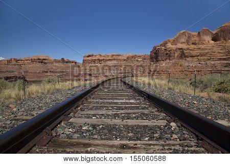Railway tracks running through the Utah desert
